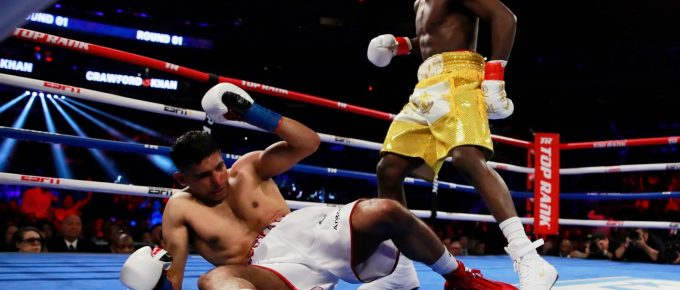 Terence Crawford dominates Amir Khan before farcical low-blow ending