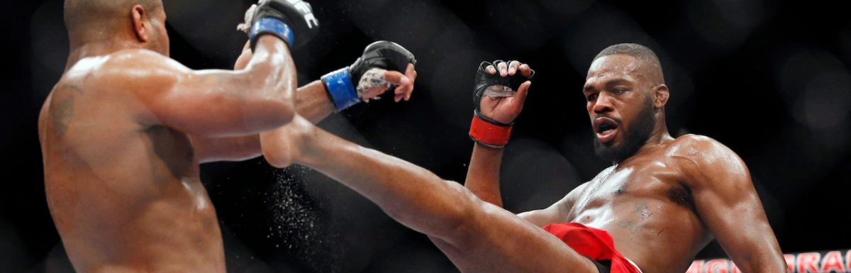 UFC 239: Jon Jones overcomes injury and Thiago Santos to retain title in kickboxing match
